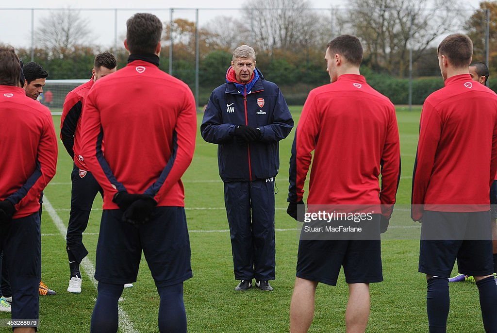 Arsenal manager speaks to his players during a training session at London Colney on December 3, 2013 in St Albans, England.