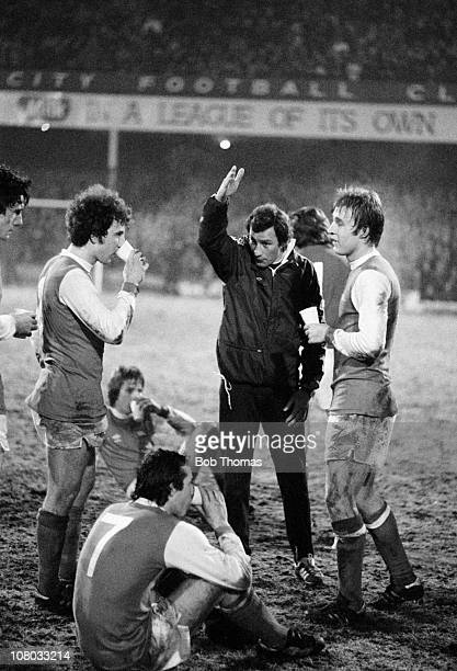 Arsenal manager Terry Neill giving instructions to his players prior to extratime in the FA Cup 3rd round 2nd replay between Arsenal and Sheffield...