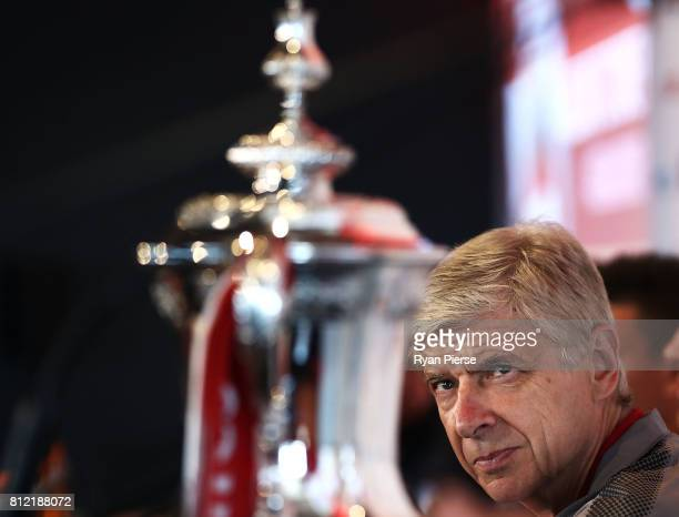 Arsenal Manger Arsene Wenger looks at the FA Cup during an Official Welcome to Sydney for Arsenal FC at Museum of Contemporary Art on July 11 2017 in...