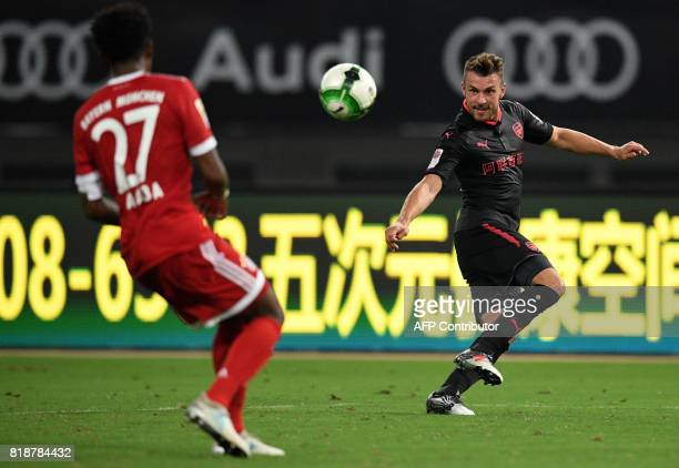 Arsenal midfielder Aaron Ramsey and Bayern Munich's defender David Alaba vie for the ball during the International Champions Cup football match...