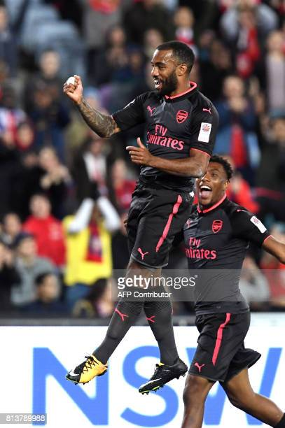 Arsenal player Alexandre Lacazette celebrates with teammate Alex Iwobi after scoring for his first goal for Arsenal in his first match during their...