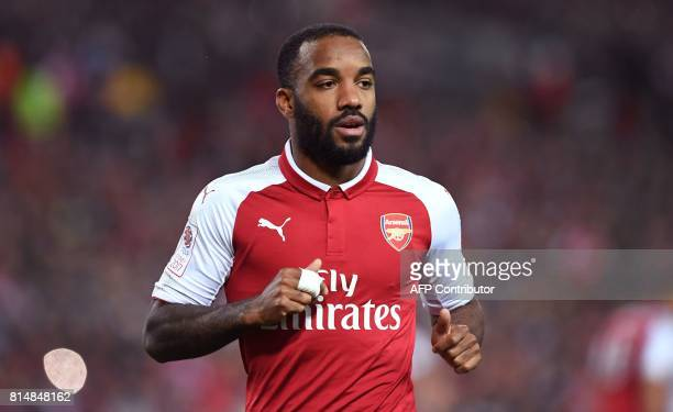 Arsenal player Alexandre Lacazette takes on Western Sydney Wanderers in their preseason football friendly played in Sydney on July 15 2017 / AFP...