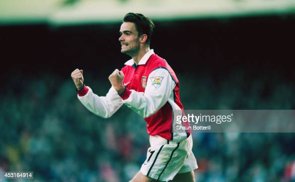 Arsenal player Marc Overmars celebrates scoring the 'winning goal' in the FA Cup 5th Round match between Arsenal and Sheffield United at Highbury The...
