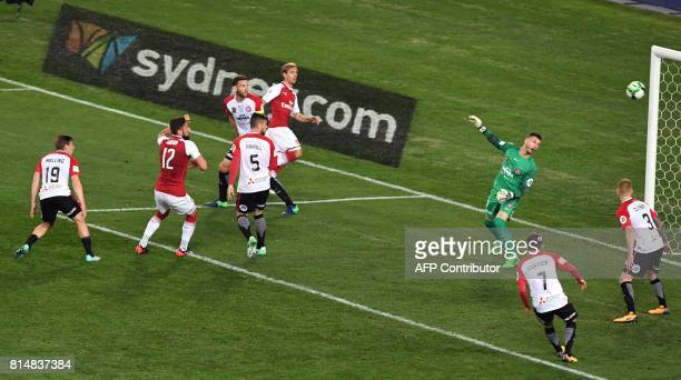 Arsenal player Olivier Giroud shoots past Western Sydney Wanderers goalkeeper Vedran Janjetovic in their preseason football friendly played in Sydney...