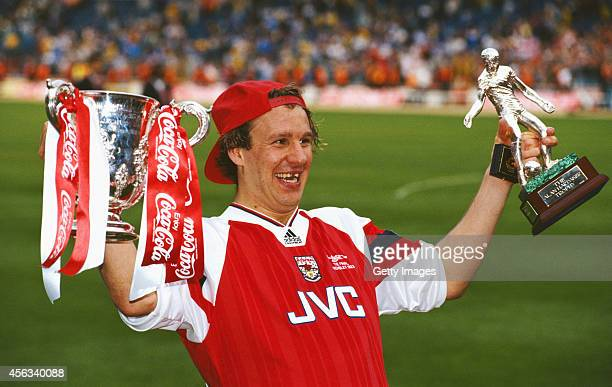 Arsenal player Paul Merson with the League Cup and man of the match trophy after the 1993 CocaCola Cup Final between Arsenal and Sheffield Wednesday...