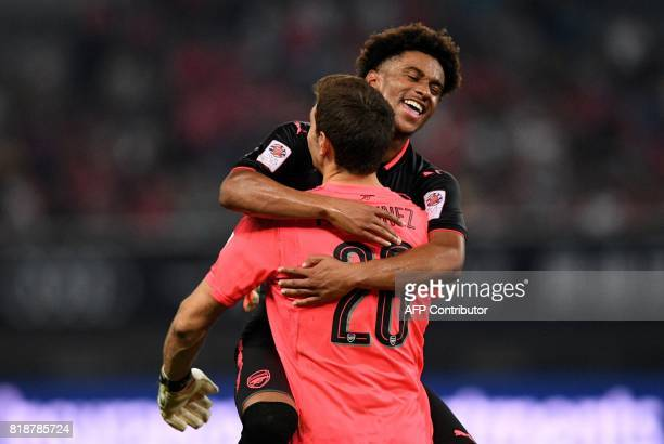 Arsenal player Reiss Nelson and Arsenal's goalkeeper Emiliano Martinez reacts after the penalty shoot out during the International Champions Cup...