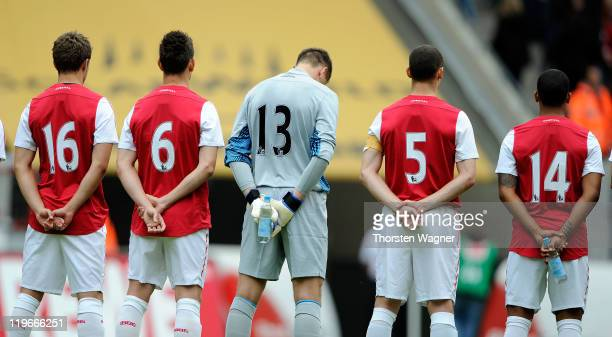Arsenal players acknowlege a moment of silence as a mark of respect for the victims of the previous day's bomb in Norway's capital Oslo and shootings...