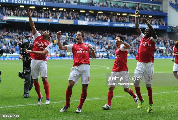 Arsenal players Andre Santos Robin van Persie Mikel Arteta and Gervinho during the Barclays Premier League match between Chelsea and Arsenal at...