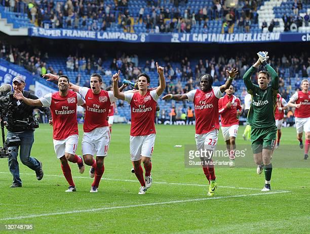 Arsenal players Andre Santos Robin van Persie Mikel Arteta Gervinho and Wojciech Szczesny during the Barclays Premier League match between Chelsea...