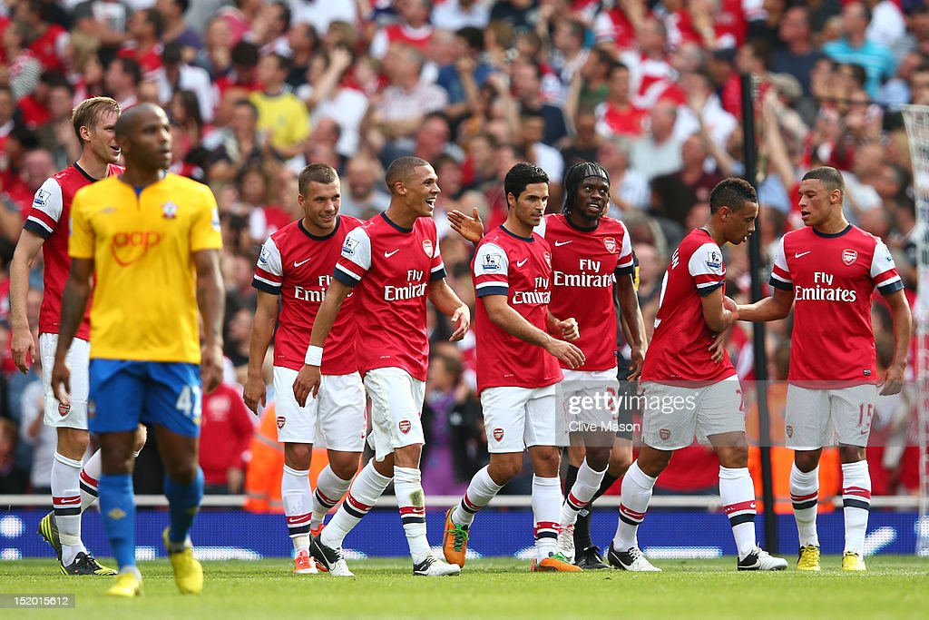 Arsenal players celebrate after Nathaniel Clyne of Southhampton scores an own goal to make it 4-0 in the first half during the Barclays Premier League match between Arsenal and Southampton at Emirates Stadium on September 15, 2012 in London, England.