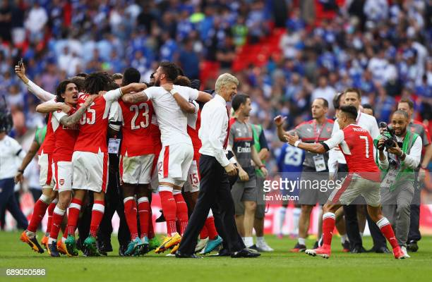 Arsenal players celebrate after The Emirates FA Cup Final between Arsenal and Chelsea at Wembley Stadium on May 27 2017 in London England