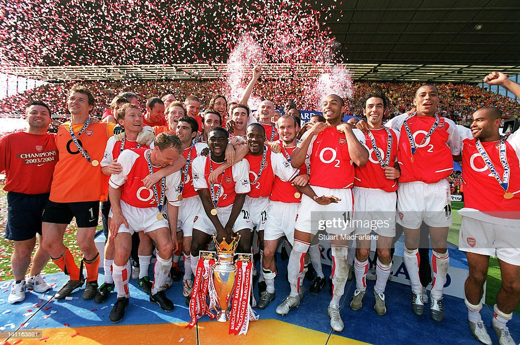 Arsenal Players celebrate beating Leicester City and winning the Premiership season, at Highbury Stadium on May 15, 2004 in London, United Kingdom.