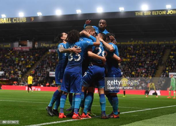 Arsenal players celebrate the goal scored by Per Mertesacker during the Premier League match between Watford and Arsenal at Vicarage Road on October...