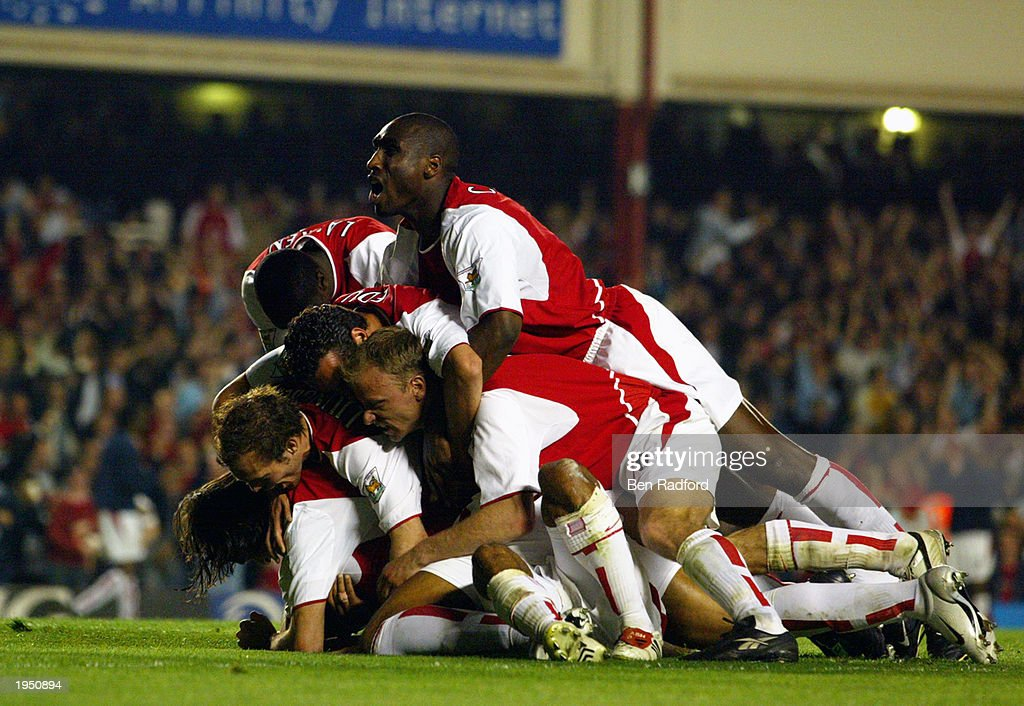 Arsenal players celebrate their first goal during the FA Barclaycard Premiership match between Arsenal and Manchester United held on April 16, 2003 at Highbury in London, England. The match ended in a 2-2 draw.
