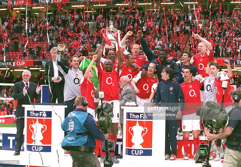 Arsenal Players celebrate winning the FA Cup Trophy at The Millennium Stadium on May 21, 2005 in Cardiff, United Kingdom. Arsenal 0:0 Manchester United. 5:4 to Arsenal after a penalty shoot out.