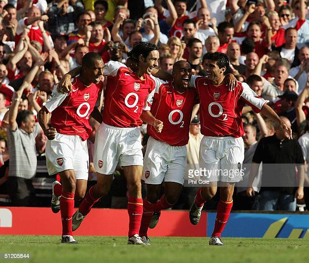 Arsenal players Gilberto Robert Pires Ashley Cole and Jose Antonio Reyes celebrate Pires' goal during the Barclays Premiership match between Arsenal...
