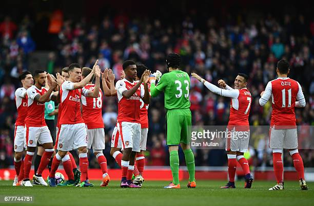 Arsenal players high five prior to the Premier League match between Arsenal and Middlesbrough at Emirates Stadium on October 22 2016 in London England