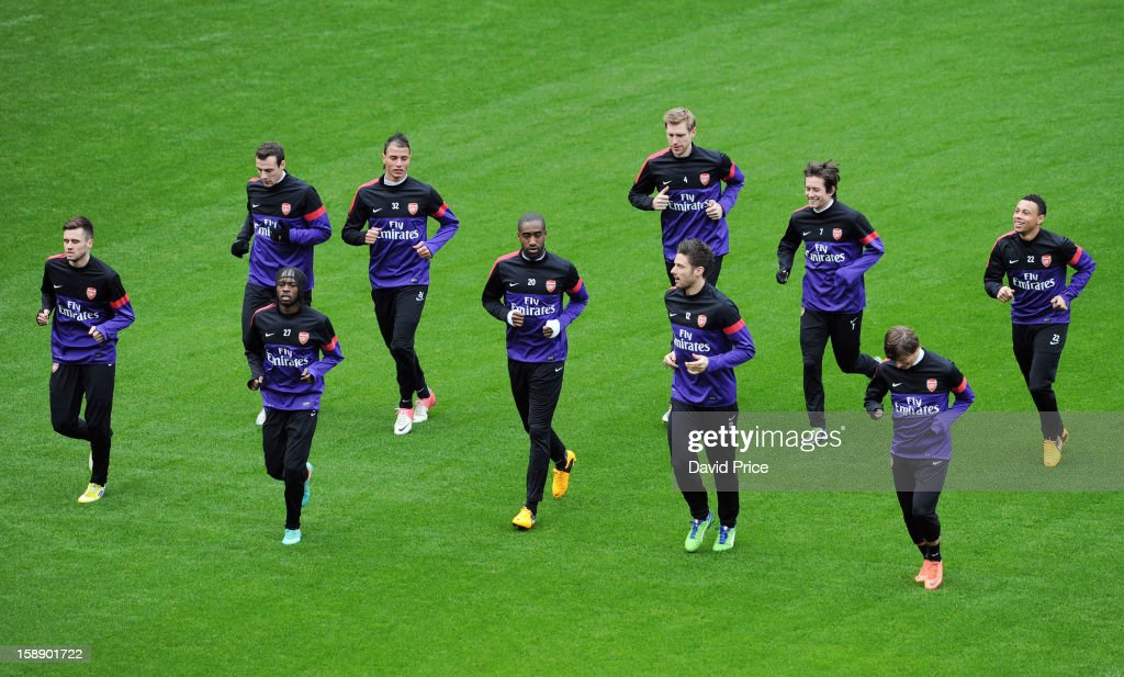 Arsenal players in action during a training session at Emirates Stadium on January 03, 2013 in London, England.
