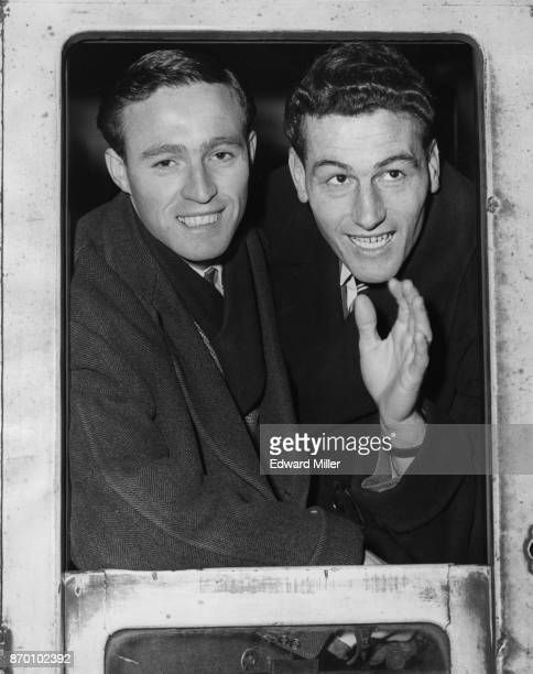 Arsenal players Jimmy Bloomfield and captain Cliff Holton leave Euston Station in London for their cuptie match with Preston North End 15th February...