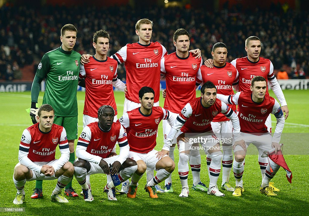 Arsenal players pose for a team photo before their UEFA Champions League group B football match against Montpellier at the Emirates Stadium, North London, England, on November 21, 2012.