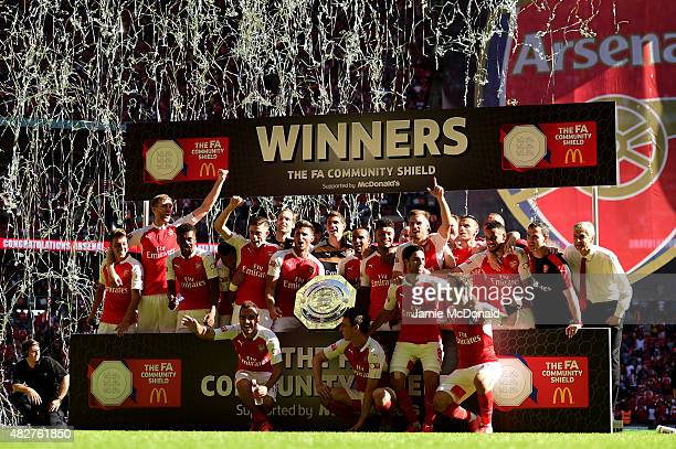 Arsenal players pose for photographs with the trophy after their team's 10 win in the FA Community Shield match between Chelsea and Arsenal at...