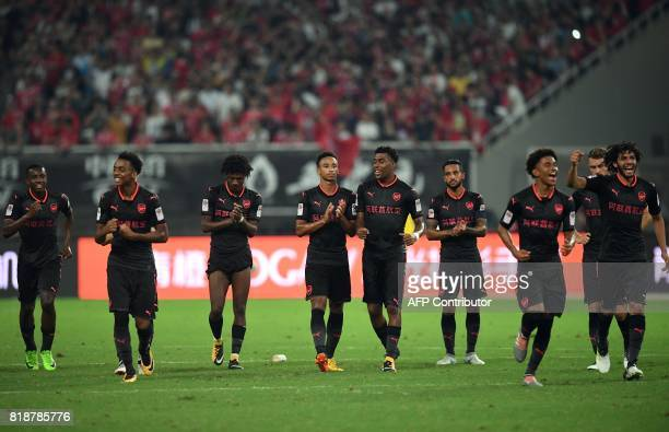 Arsenal players react after winning the penalty shootout during the International Champions Cup football match between Bayern Munich and Arsenal in...