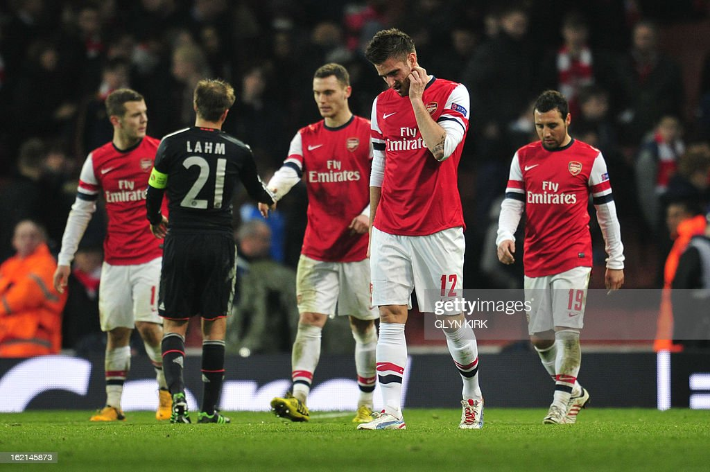 Arsenal players react at the final whistle after Arsenal lost the UEFA Champions League round of 16 football match between Arsenal and Bayern Munich at the Emirates Stadium in north London on February 19, 2013. Bayern Munich won 3-1.
