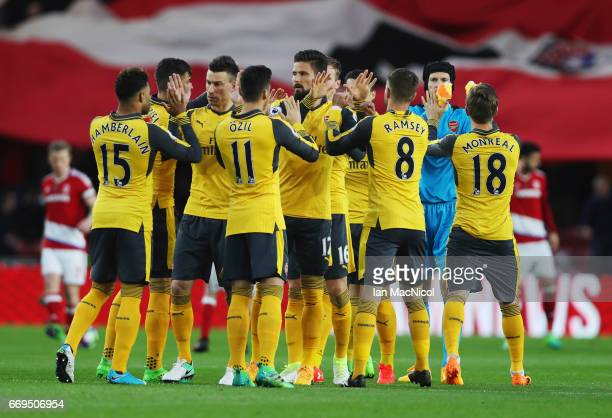 Arsenal players shake hands prior to the Premier League match between Middlesbrough and Arsenal at Riverside Stadium on April 17 2017 in...