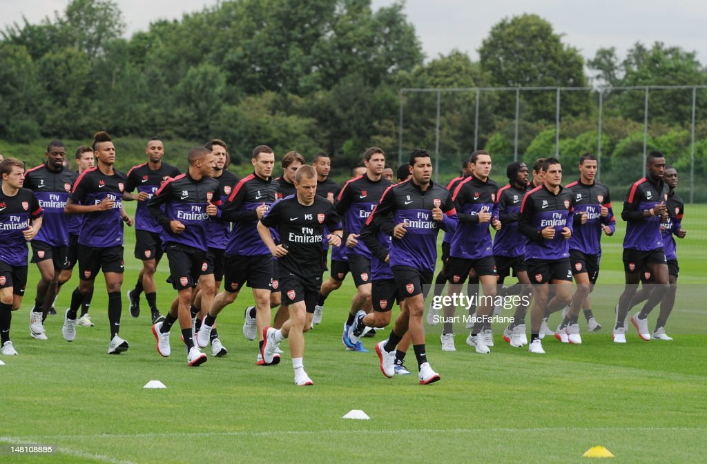 Arsenal players warm up during a training session at London Colney on July 10, 2012 in St Albans, England.