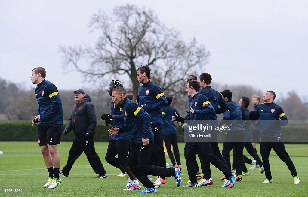 Arsenal players, warm up during a training session at London Colney ahead of tomorrow's UEFA Champions League Group B match against Montpellier on November 20, 2012 in St Albans, England.