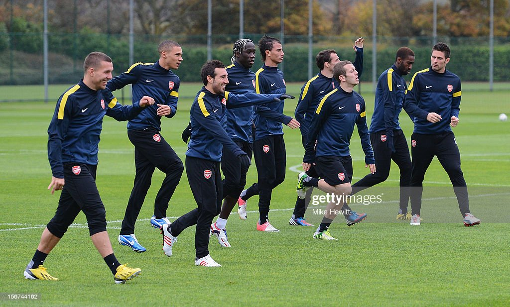 Arsenal players warm up during a training session at London Colney ahead of tomorrow's UEFA Champions League Group B match against Montpellier on November 20, 2012 in St Albans, England.