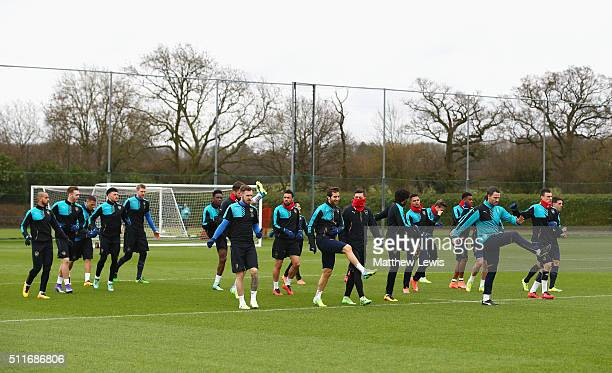 Arsenal players warm up during an Arsenal training session ahead of the UEFA Champions League match against Barcelona at London Colney on February 22...