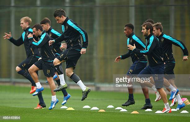 Arsenal players warm up during an Arsenal training session on the eve of the UEFA Champions League Group F match against Bayern Munich at London...