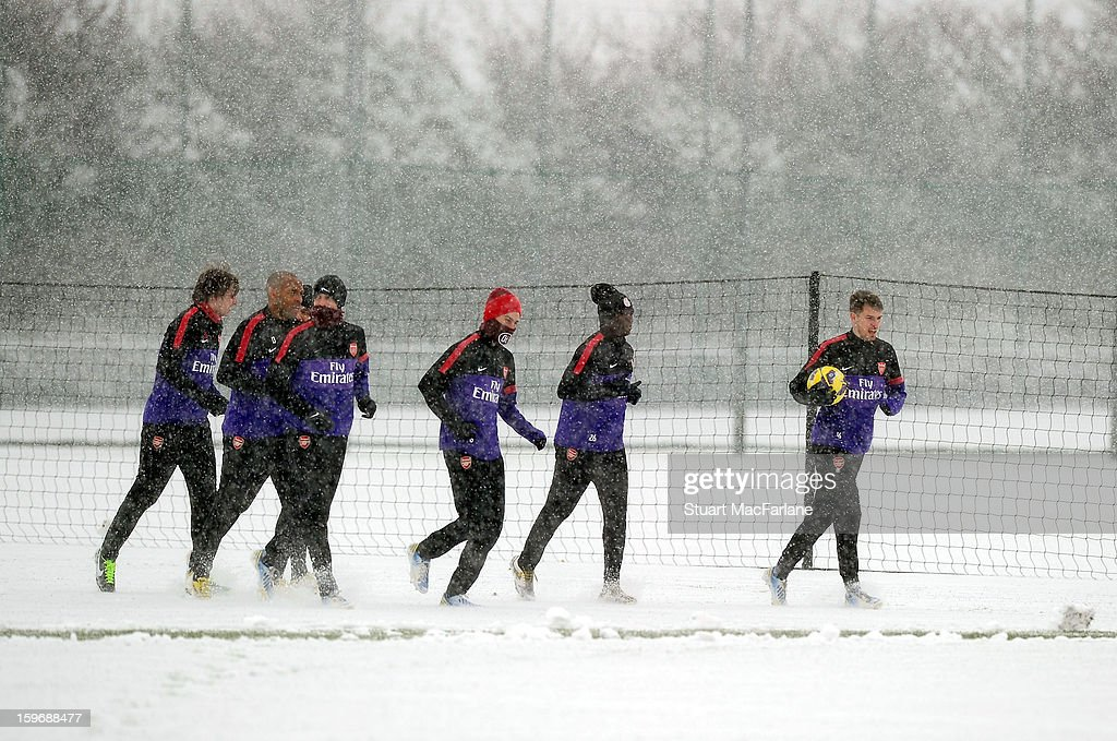 Arsenal players warm-up before a training session at London Colney on January 18, 2013 in St Albans, England.