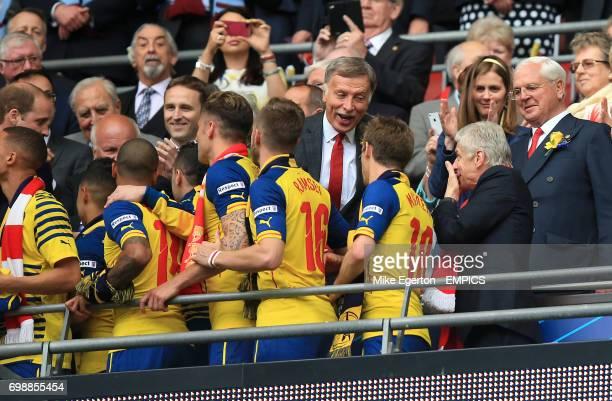 Arsenal shareholder Stan Kroenke congratulates manager Arsene Wenger