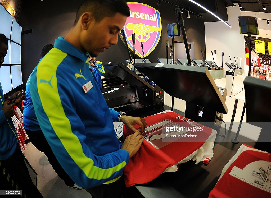 Arsenal shop staff print new signing Alexis Sanchez shirts for supporters at the Armoury Store at Emirates Stadium on July 11, 2014 in London, England.