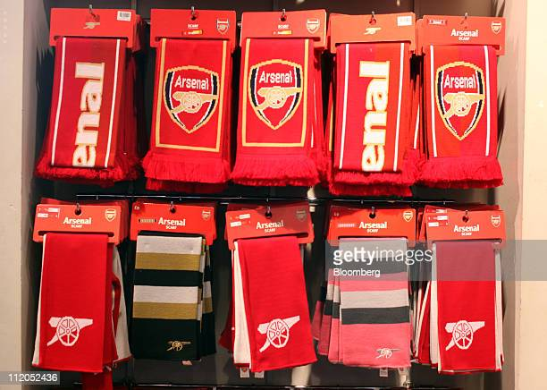 Arsenal soccer club scarves are displayed inside the Emirates stadium shop in London UK on Tuesday April 12 2011 Stan Kroenke the owner of National...