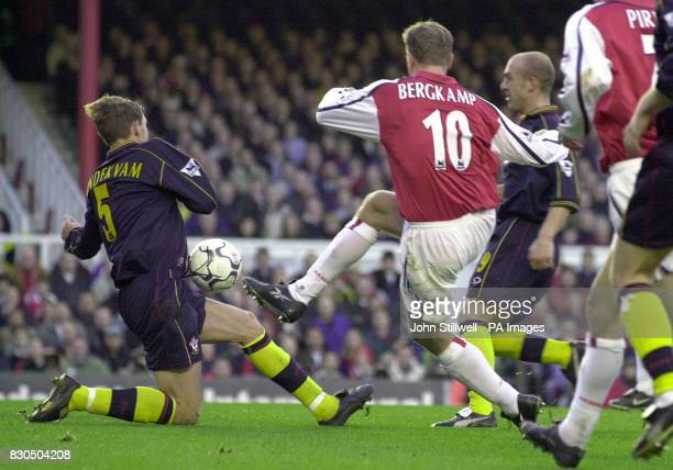 LEAGUE Arsenal striker Denis Bergkamp fires the ball into the midriff of Claus Lundekvam of Southampton during the Premiership match at Highbury in...