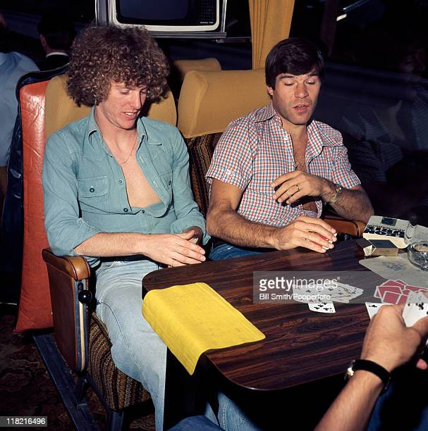 Arsenal striker Malcolm MacDonald and Graham Rix playing cards on the team bus during the journey home after their away match against Norwich City...