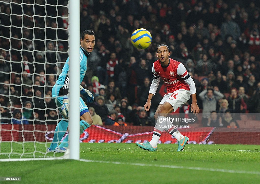 Arsenal striker Theo Walcott's header hits the post as Swansea goalkeeper Michel Vorm looks on during the FA Cup Third Round Replay match between Arsenal and Swansea City at the Emirates Stadium on January 16, 2013 in London, England.