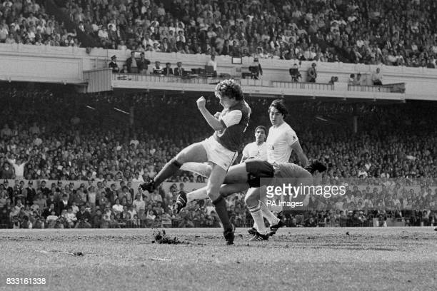 Arsenal striker Tony Woodcock is denied by Spurs goalkeeper Tony Parks as Tottenham defenders Danny Thomas and Paul Miller look on