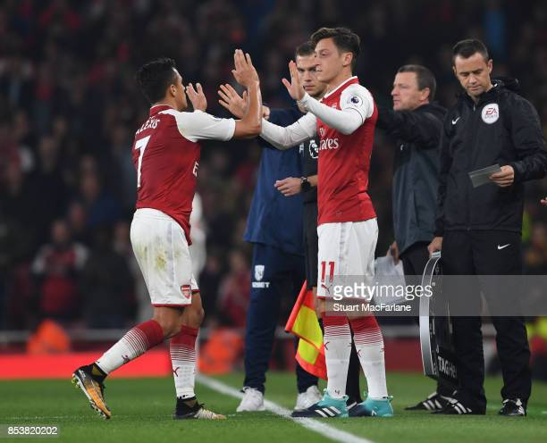 Arsenal substitute Mesut Ozil comes on for Alexis Sanchez during the Premier League match between Arsenal and West Bromwich Albion at Emirates...