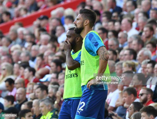 Arsenal substitutes Alex Lacazette and Olivier Giroud during the Premier League match between Liverpool and Arsenal at Anfield on August 27 2017 in...