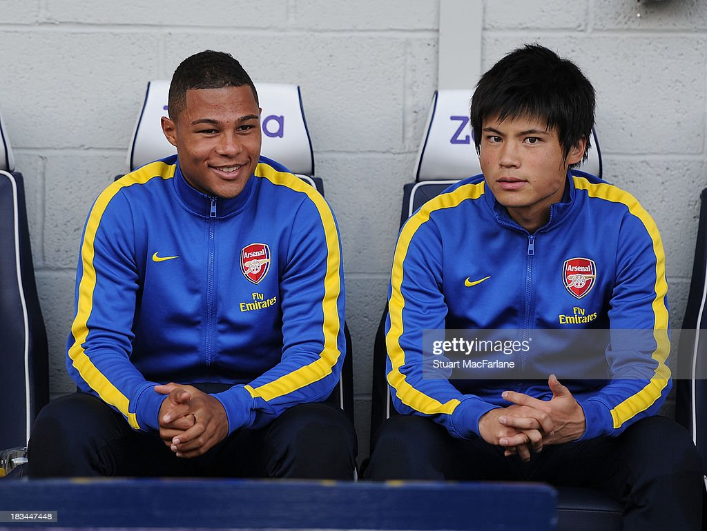 Arsenal substitutes (L-R) <a gi-track='captionPersonalityLinkClicked' href=/galleries/search?phrase=Serge+Gnabry&family=editorial&specificpeople=7257697 ng-click='$event.stopPropagation()'>Serge Gnabry</a> and <a gi-track='captionPersonalityLinkClicked' href=/galleries/search?phrase=Ryo+Miyaichi&family=editorial&specificpeople=6444719 ng-click='$event.stopPropagation()'>Ryo Miyaichi</a> before the Barclays Premier League match between West Bromwich Albion and Arsenal FC at The Hawthorns on October 6, 2013 in West Bromwich, England.