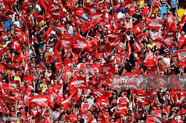 Arsenal supporters celebrate their team's 10 win in the FA Community Shield match between Chelsea and Arsenal at Wembley Stadium on August 2 2015 in...