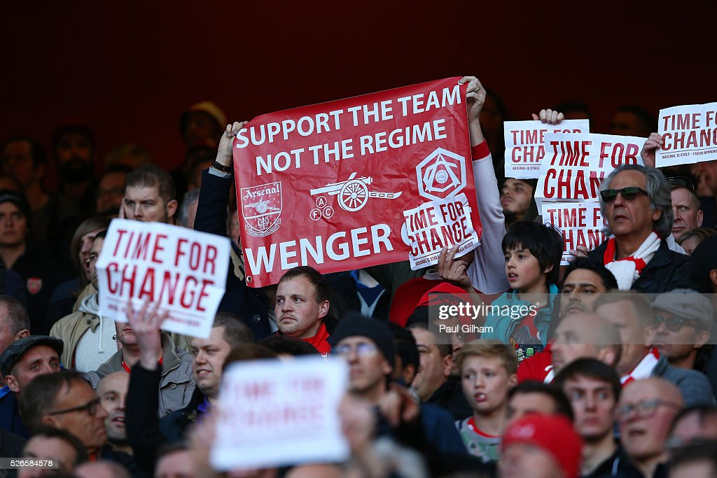 Arsenal supporters hold banners 'Time For Change' and a message for Arsene Wenger, manager of Arsenal during the Barclays Premier League match between Arsenal and Norwich City at The Emirates Stadium on April 30, 2016 in London, England