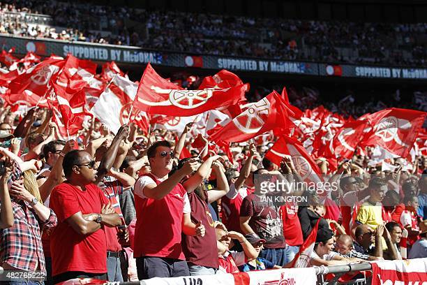 Arsenal supporters wave flags during the FA Community Shield football match between Arsenal and Chelsea at Wembley Stadium in north London on August...
