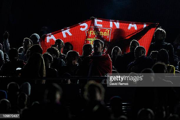 Arsenal supporters waves an Arsenal flag during the UEFA Champions League round of 16 second leg match between Barcelona and Arsenal at the Camp Nou...