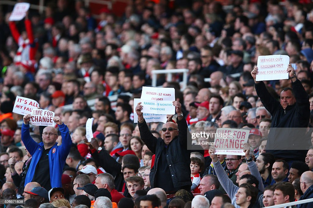 Arsenal supportes hold banners during the Barclays Premier League match between Arsenal and Norwich City at The Emirates Stadium on April 30, 2016 in London, England