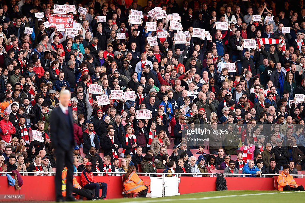 Arsenal supportes hold banners 'Time For Change' during the Barclays Premier League match between Arsenal and Norwich City at The Emirates Stadium on April 30, 2016 in London, England